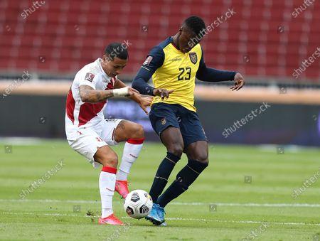 Ecuador's Moises Caicedo, right, and Peru's Yoshimar Yotun fight for the ball during a qualifying soccer match for the FIFA World Cup Qatar 2022 at Rodrigo Paz Delgado stadium in Quito, Ecuador