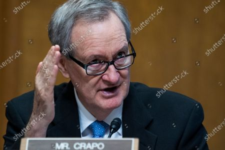 """Stock Picture of UNITED STATES - JUNE 8: Ranking member Sen. Mike Crapo, R-Idaho, questions Charles P. Rettig, commissioner of the Internal Revenue Service, during the Senate Finance Committee hearing titled """"The IRS's Fiscal Year 2022 Budget,"""" in Dirksen Senate Office Building in Washington, D.C.,."""