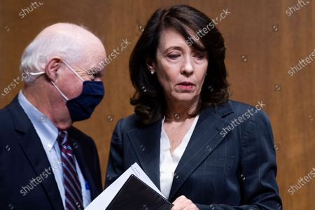 """UNITED STATES - JUNE 8: Sens. Maria Cantwell, D-Wash., and Ben Cardin, D-Md., are seen as Charles P. Rettig, commissioner of the Internal Revenue Service, testifies during the Senate Finance Committee hearing titled """"The IRS's Fiscal Year 2022 Budget,"""" in Dirksen Senate Office Building in Washington, D.C.,."""