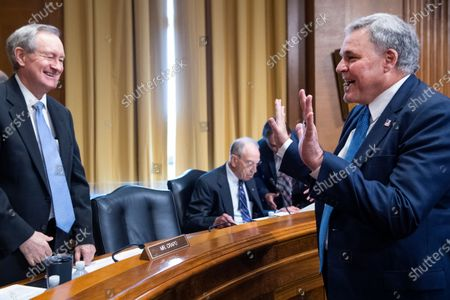 """Stock Image of UNITED STATES - JUNE 8: Charles P. Rettig, right, commissioner of the Internal Revenue Service, greets ranking member Sen. Mike Crapo, R-Idaho, before testifying during the Senate Finance Committee hearing titled """"The IRS's Fiscal Year 2022 Budget,"""" in Dirksen Senate Office Building in Washington, D.C.,."""