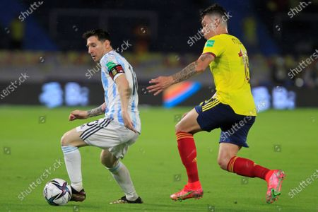 Mateus Uribe (R) of Colombia in action against Lionel Messi of Argentina during the South American qualifiers match for the Qatar 2022 World Cup, at the Metropolitano Stadium in Barranquilla, Colombia, 08 June 2021.