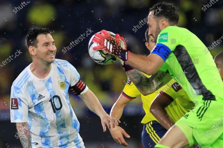 Colombia's goalkeeper David Ospina (R) in action against Lionel Messi of Argentina during the South American qualifiers match for the Qatar 2022 World Cup, at the Metropolitano Stadium in Barranquilla, Colombia, 08 June 2021.