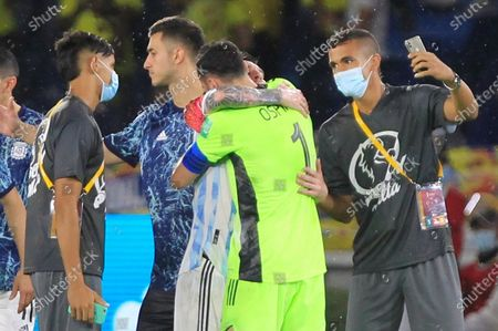 Colombia's goalkeeper David Ospina (C) hugs Argentina's Lionel Messi at the end of the South American qualifiers match for the Qatar 2022 World Cup, at the Metropolitano Stadium in Barranquilla, Colombia, 08 June 2021.