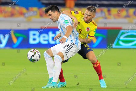 Gustavo Cuellar (R) of Colombia in action against Marcos Acuna of Argentina during the South American qualifiers for the Qatar 2022 World Cup, at the Metropolitano Stadium in Barranquilla, Colombia, 08 June 2021.