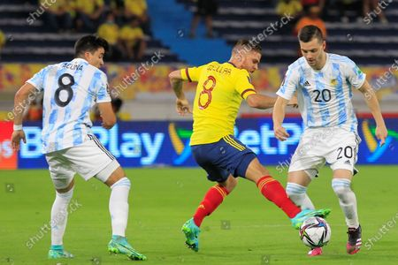 Gustavo Cuellar (C) of Colombia in action against Marcos Acuna (L) and Giovani Lo Celso of Argentina during the South American qualifiers for the Qatar 2022 World Cup, at the Metropolitano Stadium in Barranquilla, Colombia, 08 June 2021.