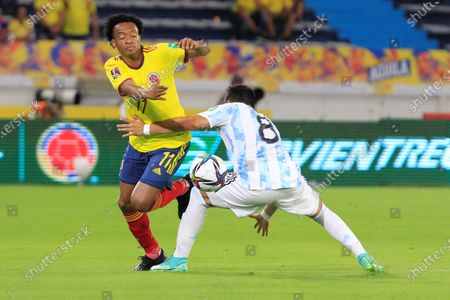 Juan Guillermo Cuadrado (L) of Colombia in action against Marcos Acuna of Argentina during the South American qualifiers for the Qatar 2022 World Cup, at the Metropolitano Stadium in Barranquilla, Colombia, 08 June 2021.