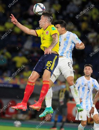 Mateus Uribe (L) of Colombia in action against Marcos Acuna and Gonzalo Montiel of Argentina during the South American qualifiers match for the Qatar 2022 World Cup, at the Metropolitano Stadium in Barranquilla, Colombia, 08 June 2021.