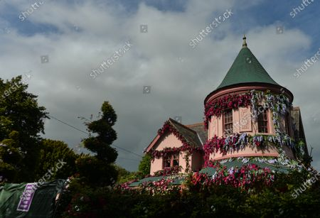 A partial view of the house in The Burnaby area of Greystones which has been covered from the roof down by stretched pink flowers and trellis-style foliage ahead of Disney's 'Disenchanted' filming starting next week.On Tuesday, 8 June 2021, in Greystones, County Wicklow, Ireland.