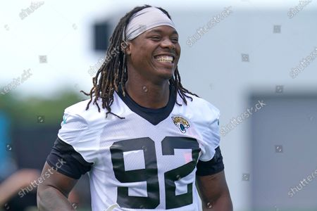 Jacksonville Jaguars defensive end Jordan Smith laughs with teammates during an NFL football team practice, in Jacksonville, Fla