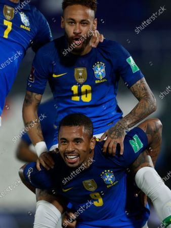 Brazil's Neymar, top, celebrates with teammate Gabriel Jesus after scoring his side's opening goal against Paraguay during a qualifying soccer match for the FIFA World Cup Qatar 2022 at Defensores del Chaco stadium in Asuncion, Paraguay