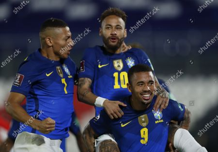 Brazil's Neymar, center, celebrates with teammates Gabriel Jesus, right, and Richarlison after scoring his side's opening goal against Paraguay during a qualifying soccer match for the FIFA World Cup Qatar 2022 at Defensores del Chaco stadium in Asuncion, Paraguay