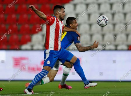 Brazil's Gabriel Jesus, right, and Paraguay's Junior Alonso battle for the ball during a qualifying soccer match for the FIFA World Cup Qatar 2022 at Defensores del Chaco stadium in Asuncion, Paraguay