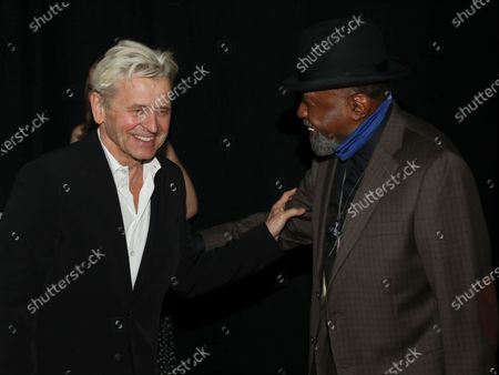 "Choreographer Mikhail Baryshnikov, left, greets actor Ben Vereen at the ""Immersive Van Gogh"" art experience opening celebration at Pier 36, in New York"