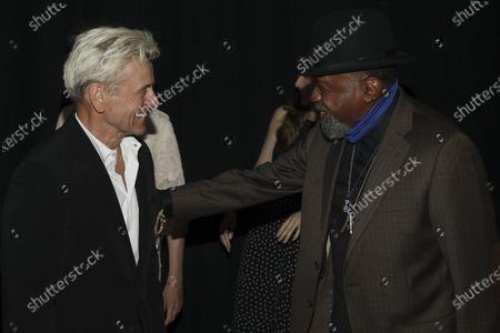 "Choreographer Mikhail Baryshnikov, left, greets actor Ben Vereen, right, at the ""Immersive Van Gogh"" art experience opening celebration at Pier 36, in New York"