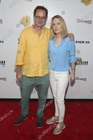"""Michael Riedel, left, and Imogen Lloyd Webber, right, attend the """"Immersive Van Gogh"""" art experience opening celebration at Pier 36, in New York"""