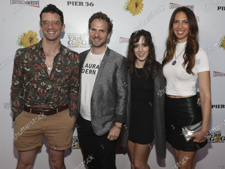 """Michael Urie, from left, Ryan Spahn, Talene Monahon and Mallory Portnoy attend the """"Immersive Van Gogh"""" art experience opening celebration at Pier 36, in New York"""