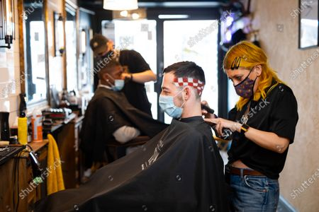 Stock Picture of BOXPARK offers football fanatics a Euros-inspired barber service with a menu of iconic football haircuts, including The Pogba leopard print, The Perisic checkerboard, The Beckham mohawk and The Gazza '96.