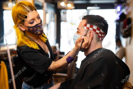 Stock Photo of BOXPARK offers football fanatics a Euros-inspired barber service with a menu of iconic football haircuts, including The Pogba leopard print, The Perisic checkerboard, The Beckham mohawk and The Gazza '96.