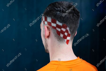 Stock Image of BOXPARK offers football fanatics a Euros-inspired barber service with a menu of iconic football haircuts, including The Pogba leopard print, The Perisic checkerboard, The Beckham mohawk and The Gazza '96.