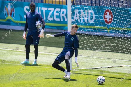 Switzerland's goalkeeper Yvon Mvogo, left, and Switzerland's goalkeeper Jonas Omlin, right, in action during a training session prior to the UEFA EURO 2020 soccer tournament at the Dalga Arena, in Baku, Azerbaijan, 09 June 2021. The UEFA EURO 2020 soccer tournament will be held from 11 June to 11 July 2021.