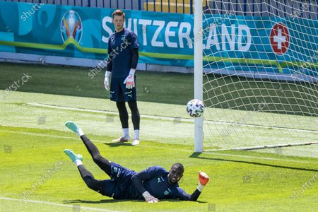 Switzerland's goalkeeper Yvon Mvogo, front, in action next to Switzerland's goalkeeper Jonas Omlin, back, during a training session prior to the UEFA EURO 2020 soccer tournament at the Dalga Arena, in Baku, Azerbaijan, 09 June 2021. The UEFA EURO 2020 soccer tournament will be held from 11 June to 11 July 2021.