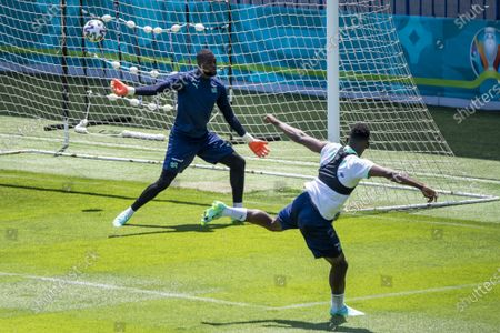 Switzerland's goalkeeper Yvon Mvogo (L) and Switzerland's soccer player Breel Embolo (R) in action during a training session prior to the UEFA EURO 2020 soccer tournament at the Dalga Arena, in Baku, Azerbaijan, 09 June 2021. The UEFA EURO 2020 soccer tournament will be held from 11 June to 11 July 2021.