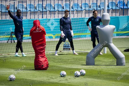 Switzerland's goalkeepers Yvon Mvogo, Jonas Omlin, Yann Sommer, from left to right, react during a training session prior to the UEFA EURO 2020 soccer tournament at the Dalga Arena, in Baku, Azerbaijan, 09 June 2021. The UEFA EURO 2020 soccer tournament will be held from 11 June to 11 July 2021.