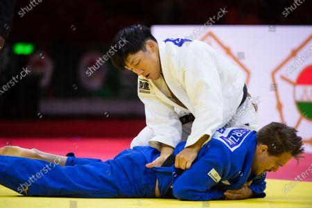 Japan's Sotaro Fujiwara men-81 kg vs Germany's Alexander Wieczerzak men-81 elimination rounds during the 2021 World Judo Championships at Budapest Sports Arena in Budapest, Hungary
