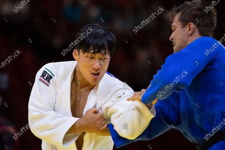 Stock Image of Japan's Sotaro Fujiwara men-81 kg vs Germany's Alexander Wieczerzak men-81 elimination rounds during the 2021 World Judo Championships at Budapest Sports Arena in Budapest, Hungary