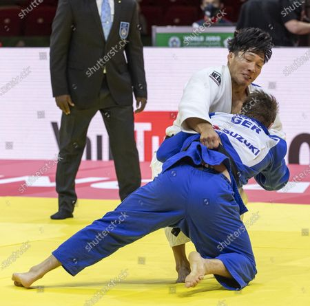 Sotaro Fujiwara (white) of Japan and Alexander Wieczerzak (blue) of Germany fight in men's -81kg category of World Judo Championships in Budapest, Hungary, 09 June 2021.