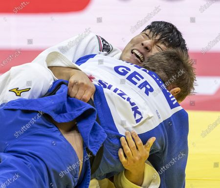 Stock Photo of Sotaro Fujiwara (white) of Japan and Alexander Wieczerzak (blue) of Germany fight in men's -81kg category of World Judo Championships in Budapest, Hungary, 09 June 2021.
