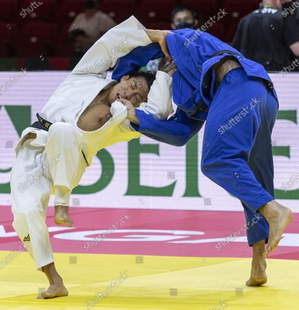 Stock Picture of Sotaro Fujiwara (white) of Japan and Alexander Wieczerzak (blue) of Germany fight in men's -81kg category of World Judo Championships in Budapest, Hungary, 09 June 2021.