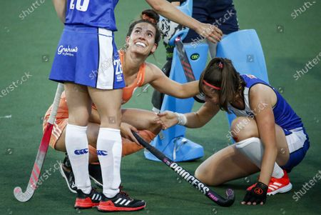 Frederique Matla (L) of the Netherlands reacts after accidentally hitting Amy Costello of Scotland during the European Hockey Championship women's pool A match between the Netherlands and Scotland at the Wagener Stadium in Amstelveen, the Netherlands, 09 June 2021.