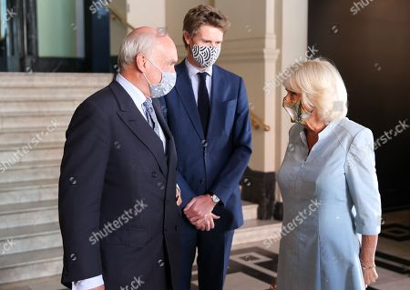 Camilla Duchess of Cornwall arrives at the V&A and is introduced Director of the V&A and Nicholas Coleridge (L) to Dr Tristram Hunt, Chair of the V&A (C) during a visit to The V&A on June 09, 2021 in London, England.