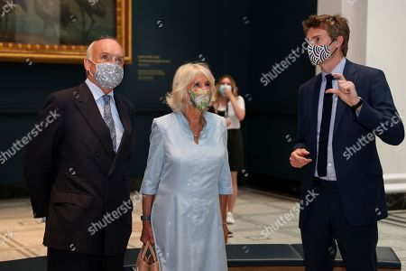 Director of the V&A, Nicholas Coleridge, Camilla Duchess of Cornwall and Dr Tristram Hunt, Director of the V&A viewing the Raphael Cartoons in the Raphael gallery at The V&A on June 09, 2021 in London, England.