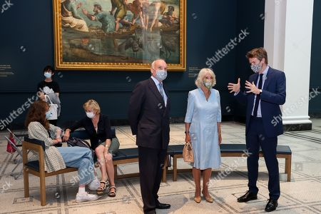 Stock Picture of Director of the V&A, Nicholas Coleridge, Camilla Duchess of Cornwall and Dr Tristram Hunt, Director of the V&A viewing the Raphael Cartoons in the Raphael gallery at The V&A on June 09, 2021 in London, England.