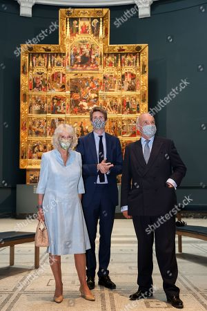 Camilla Duchess of Cornwall, Director of the V&A, Dr Tristram Hunt and Nicholas Coleridge, Chair of the V&A viewing the Raphael Cartoons in the Raphael gallery at The V&A on June 09, 2021 in London, England.
