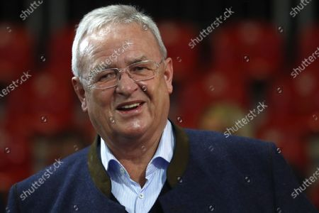 Martin Winterkorn, former CEO of the German car manufacturer 'Volkswagen', arrives for the annual general meeting of FC Bayern Munich soccer club in Munich, Germany. Volkswagen says the executive in charge during the company's diesel scandal will pay the firm 11.2 million euros ($13.6 million) in compensation. The company said in a statement that an investigation showed former CEO Martin Winterkorn failed to get to the bottom of the scandal quickly after regulators started asking questions, and didn't ensure truthful answers to the inquiries