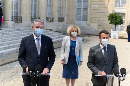 Mathias Cormann, Muriel Penicaud and Emmanuel Macron.
