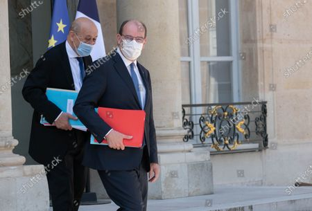 French Foreign Minister Jean-Yves Le Drian and French Prime Minister Jean Castex leave after the weekly cabinet meeting at Elysee Palace.