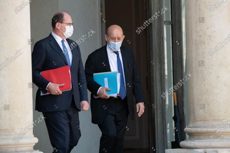 French Prime Minister Jean Castex and French Foreign Minister Jean-Yves Le Drian leave after the weekly cabinet meeting at Elysee Palace.
