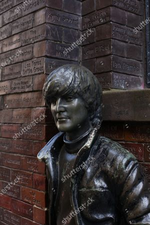 John Lennon statue in front of Wall of Fame. Sculpted by David Webster, outside Cavern Pub, Mathew Street, Liverpool