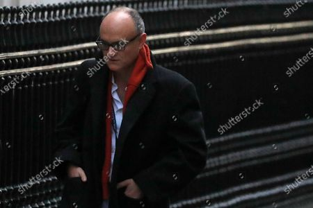 """Stock Photo of Dominic Cummings Chief Adviser to Britain's Prime Minister Boris Johnson arrives in Downing Street in London. Britain's High Court has ruled that the U.K. government acted unlawfully in awarding a contract to a company run by friends of the former top adviser to Prime Minister Boris Johnson. A judge ruled Wednesday, June 9, 2021 that a June 2020 decision by Cabinet Office minister Michael Gove to pay more than 500,000 pounds ($700,000) to market research firm Public First """"gave rise to apparent bias and was unlawful"""