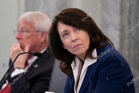 Stock Photo of Sen. Maria Cantwell, D-Wash., chair of the Senate Commerce, Science, and Transportation Committee, joined at left by Sen. Roger Wicker, R-Miss., holds a hearing on student athlete compensation and federal legislative proposals to enable athletes participating in collegiate sports to monetize their name, image, and likeness, at the Capitol in Washington