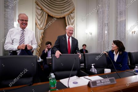 Stock Image of From left, Sen. Jerry Moran, R-Kan., Sen. Roger Wicker, R-Miss., and Sen. Maria Cantwell, D-Wash., chair of the Senate Commerce, Science, and Transportation Committee, prepare to hold a hearing on student athlete compensation and federal legislative proposals to enable athletes participating in collegiate sports to monetize their name, image, and likeness, at the Capitol in Washington