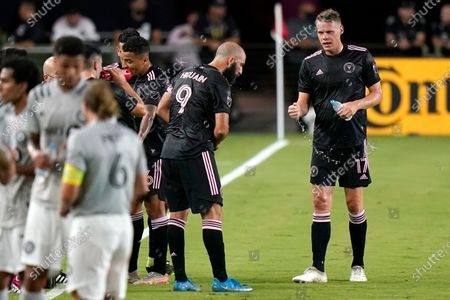 Stock Image of Inter Miami forward Gonzalo Higuain (9) and defender Ryan Shawcross (17) talk during the first half of a MLS soccer match against CF Montréal, in Fort Lauderdale, Fla