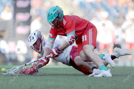 Whipsnakes' Joe Nardella (91) snatches the ball from Chaos' Max Adler (9) during a Premier Lacrosse League game, in Foxborough. The Whipsnakes won 13-7
