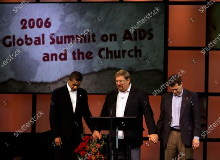 Sen. Barack Obama, (D) Illinois, left, and Sen. Sam Brownback, (R) Kansas, right, pray with Saddleback Church pastor and author Rick Warren at the 2006 Global Summit on AIDS and Church at Saddleback Church in Lake Forest Friday, Dec. 1, 2006. Obama is a lightning rod for fundamentalist Christians, who oppose his liberal views.