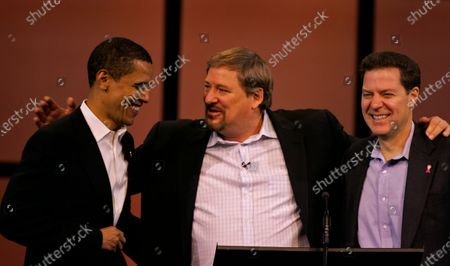Sen. Barack Obama, (D) Illinois, left, and Sen. Sam Brownback, (R) Kansas, right, share a laugh before praying with Saddleback Church pastor and author Rick Warren at the 2006 Global Summit on AIDS and Church at Saddleback Church in Lake Forest Friday, Dec. 1, 2006. Obama is a lightning rod for fundamentalist Christians, who oppose his liberal views.