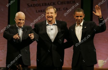 LAKE FOREST, CA - AUGUST 16, 2008 -- Sen. John McCain, left, Dr. Rick Warren and Sen. Barack Obama, right, acknowledge the applause of the audience while making their first joint appearance of the 2008 campaign during the Saddleback Civil Forum at the Saddleback Church on August 16, 2008. Dr. Rick Warren is founding pastor of the church.